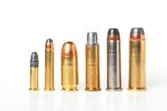 La talla de la munición del punto negro compara. Imagen de archivo libre de regalías