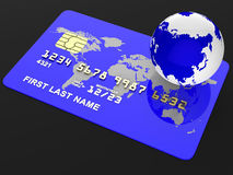 La tarjeta de crédito representa la compra del debe y la globaliza Fotografía de archivo