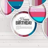 La tarjeta de cumpleaños con los globos y el cumpleaños mandan un SMS encendido Fotos de archivo