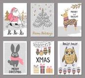 La tarjeta de felicitación de la Feliz Navidad fijó con santa lindo, el árbol, los ciervos, el conejo, el búho y otros elementos  Fotos de archivo libres de regalías