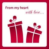 La tarjeta de la tarjeta del día de San Valentín con los regalos. Foto de archivo