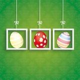 La tarjeta de pascua adorna 3 marcos de los huevos Fotografía de archivo