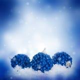 La tarjeta del Año Nuevo con las bolas azules Foto de archivo libre de regalías