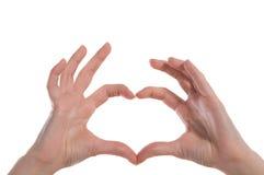 La tarjeta del día de San Valentín del St. \ 'el haert del día de s formaron los dedos Imagen de archivo