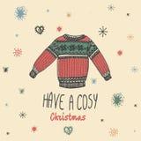 La tarjeta del vintage de la Navidad con con el suéter dibujado mano y el texto 'tienen una Navidad acogedora' libre illustration