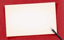 La tarjeta en blanco blanca del vintage con el lápiz en el papel del arte, imita para arriba para Fotos de archivo