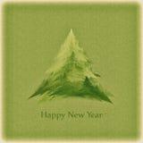 La tarjeta retra del Año Nuevo con un árbol de navidad verde Foto de archivo libre de regalías