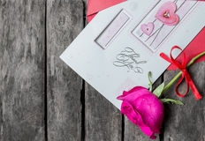 La tarjeta y se levantó Imagen de archivo libre de regalías