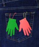 La tasca dei jeans e delle palme di carta Immagine Stock