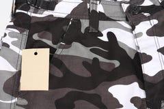 La tasca di camoflage del primo piano B&W mette con l'etichetta (per Immagine Stock