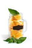 La tasse de smoothies avec des oranges dans elle Photos stock