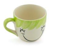 la tasse du café et du support soit forme de visage de sourire Photos libres de droits