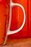 La tasse rouge, colorent le rouge Photos libres de droits