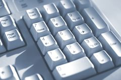 La tastiera abbottona il tono blu immagini stock