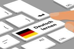La tastiera tedesca con il bottone bianco impara il tedesco - computer o computer portatile con le dita e la bandiera tedesca - i Fotografia Stock