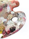 La tavolozza degli artisti con i colori si mescola sopra fondo bianco Fotografia Stock