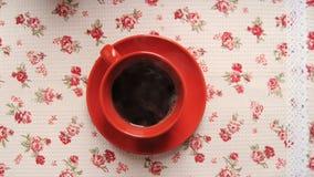 La taza de cofee con las galletas para la animación del movimiento