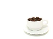 La taza de granos de café Fotos de archivo