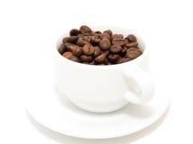 La taza de granos de café Imagen de archivo libre de regalías