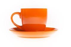La tazza arancio del tè con il piattino Fotografia Stock Libera da Diritti