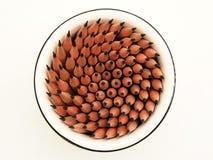 La tazza delle matite taglienti Immagine Stock
