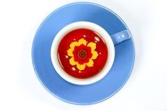 La tazza di tè con il fiore Fotografia Stock