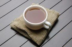 La tazza di tè nel concetto di approvvigionamento Fotografia Stock