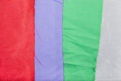 La tela colorida corta el backgroud o la textura foto de archivo libre de regalías