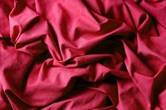 La tela roja arrugada Fotografía de archivo libre de regalías