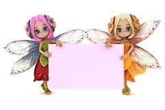 La tenencia de dos hadas lindas una tarjeta rosada en blanco del anuncio Imagen de archivo