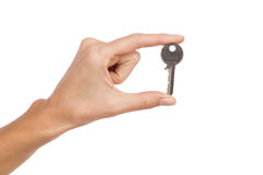 La tenencia de la mano de la mujer una llave Fotos de archivo libres de regalías