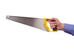 La tenencia de la mano del trabajador de sexo masculino crosscut el handsaw Foto de archivo libre de regalías