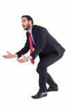 La tenuta di piegamento dell'uomo d'affari distribuisce mentre cerca Immagini Stock Libere da Diritti