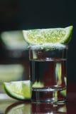 La tequila con calce fotografia stock