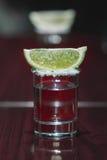 La tequila con calce Immagini Stock
