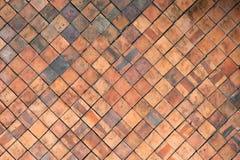La terracotta piastrella la parete per il fondo astratto di struttura Fotografie Stock