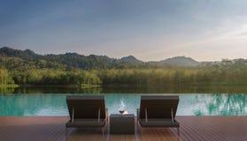 La terrasse de piscine et la belle nature regardent l'image du rendu 3d Image libre de droits