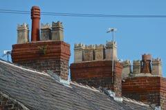 La terrasse loge des pots de cheminée Image stock