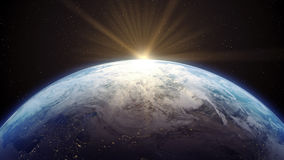 La terre avec l'augmentation de Sun Image stock