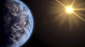 La terre avec l'augmentation de Sun Image libre de droits