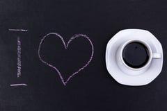 La terre avec le texte d'amour d'I et la tasse de café Images stock