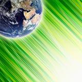 La terre dans l'herbe verte Photo libre de droits