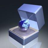 La terre dans le cadre de cadeau Photographie stock libre de droits