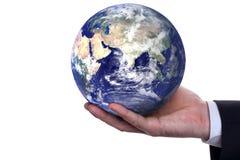 La terre dans une main   Photographie stock libre de droits