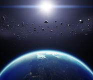 la terre de la planète 3D avec des asteroïdes Éléments de cette image meublés Image libre de droits