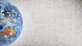 La terre de planète contre le mur en béton, pièce gauche d'écran Image stock