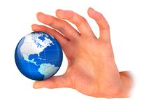 La terre de planète dans la main photo stock