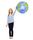 La terre de planète de dessin de fille dans le ciel Photographie stock