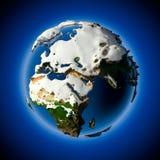 La terre de planète est couverte par la neige Photographie stock
