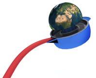 La terre de planète serrée sur le presse-fruits Photo libre de droits